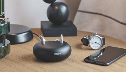 Oticon OPNs bluetooth hearing aids, recharging base & 5yr service plan.
