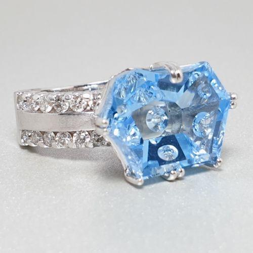 Image 1 for 14k WG blue topaz & 0.72ctw I1, GH Dia Ring